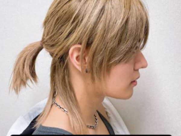Yuta de NCT sorprende a sus fans al lucir una larga cabellera